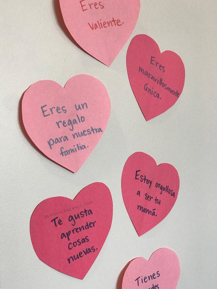 50 positive affirmations to tell your child - with free English and Spanish printables.